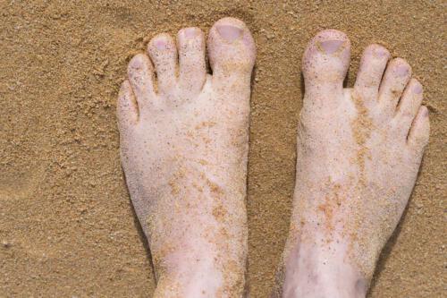 Neuseeland-Strand-Sand-Fuesse